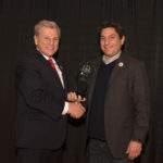 "Michael Madsen, AST Publisher, presenting Cliff Quiroga, Vice President for Sharp Robotics Business Development with the Sharp Electronics, 2017 'ASTORS' ""Leadership & Innovation in Homeland Security"" Award"