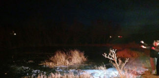 Search-and-rescue workers at a frozen pond Monday in New Harmony, Utah, where a sheriff's sergeant rescued a drowning 8-year-old boy.(Image courtesy of the Washington County Sheriff's Office)