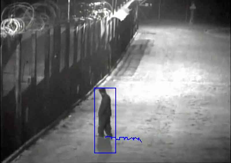 Video footage of a person being tracked as they approach the fence. In this scenario, a PTZ camera can be directed towards the potential intruder before an actual intrusion attempt is made.