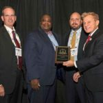 Reid Hilliard, Assistant Director, Department of Justice (DOJ), Kevin McCombs, Director of Security Services, US Office of Personnel Management (OPM) and John Rossiter, Senior Security Specialist, Securities and Exchange Commission (SEC) accepting a 2018 'ASTORS' Homeland Security Award at ISC East.