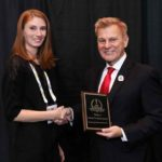 Alyssa Cronin, Marketing & Communication Specialist, TCOM, accepting the company's 2018 'ASTORS' Homeland Security Award at ISC East.