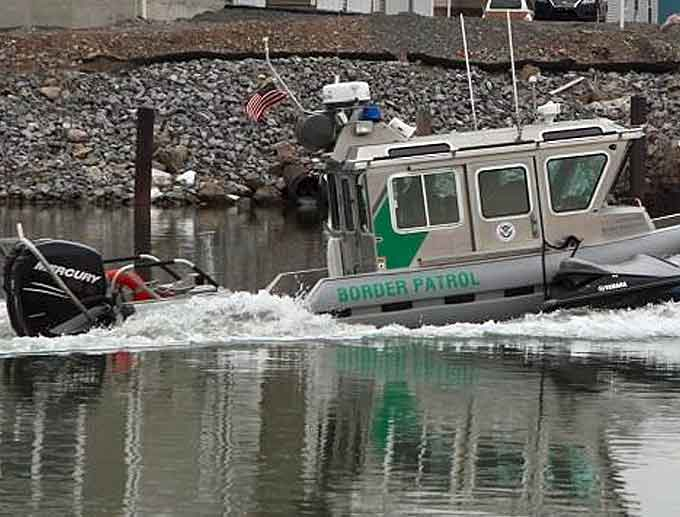 This is the Jet Ski used during the smuggling attempt,alongside a Border Patrol SAFE Boat. (Courtesy of CBP)