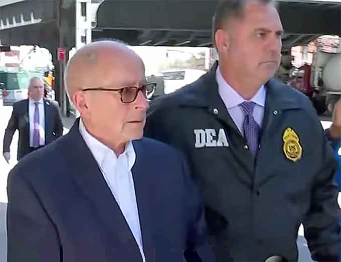 Former Rochester Drug Co-Operative CEO Laurence Doud III, is taken into custody and facing criminal charges stemming from the opioid crisis. (Courtesy of YouTube)