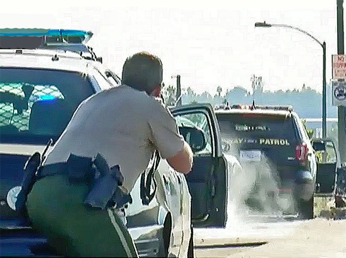 The cop killer, identified Tuesday as Aaron Luther, 49, of Beaumont, was driving a white GMC pickup truck Monday when he was stopped by a motorcycle officer on an overpass to Interstate 215 in Riverside. (Courtesy of YouTube)