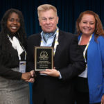 Carrie Howard and Liz Newkirk of Advanced Detection Technology accepting the company's 2019 'ASTORS' Awards Program.