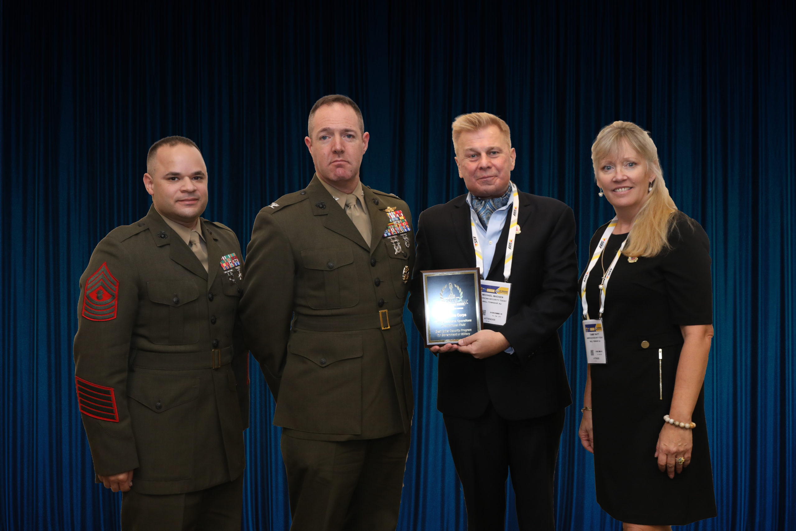 Colonel Seth Milstein and Master Gunnery Sergeant Carlos Torres accepting the 1700 Cyberspace OccFld Platinum 'ASTORS' Award at the 2019 'ASTORS' Awards Luncheon at ISC East.